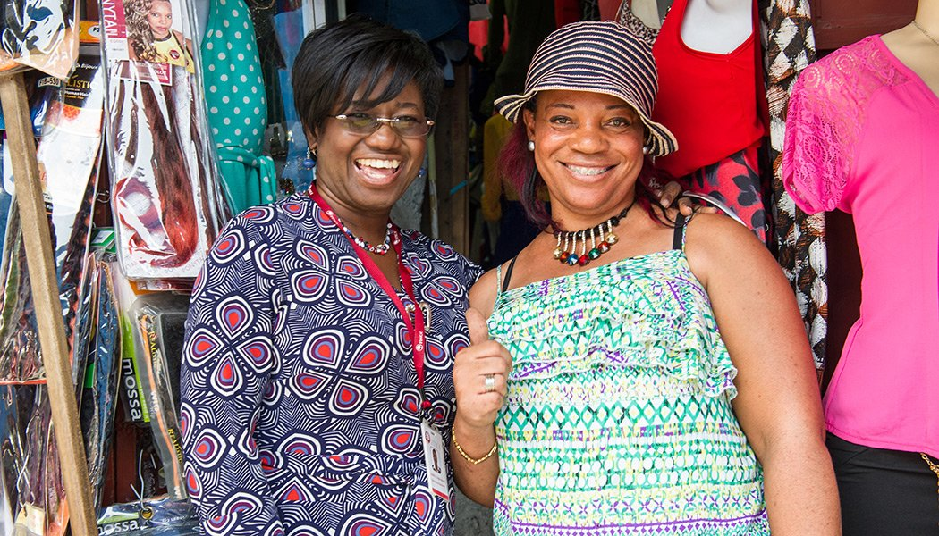Marie Marcelle Gerard Saint-Gilles, the CEO of FINCA, with a client