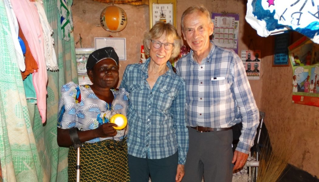 Mwangaza project client Joyce Ajidiru holdin her Pico lamp with Karen and Ken Gerdes.