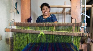 Nicolasa Sacay weaving on her loom