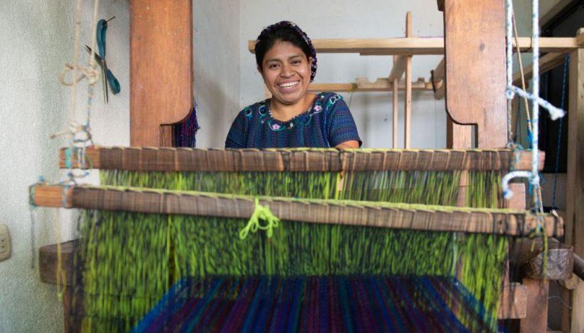 Nicolasa Sacay weaving on her loom
