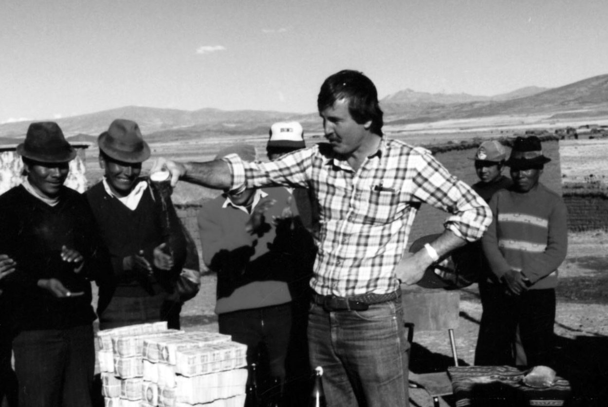 John hatch disbursing his first loan in Bolivia