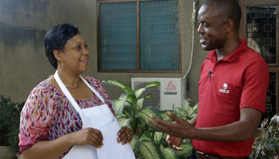 Jane-Speaking-With-A-FINCA-Officer