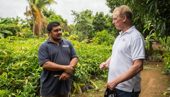 Rupert Scofield meets with a FINCA client and farmer in Nicaragua