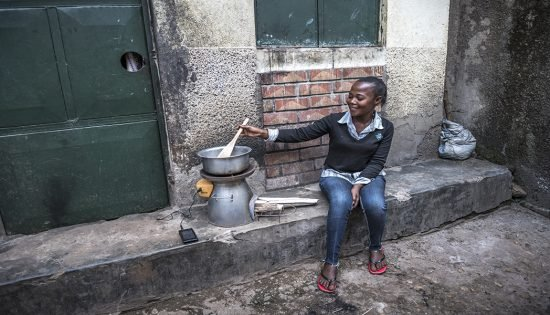 BrightLife client cooking using BioLite cookstove