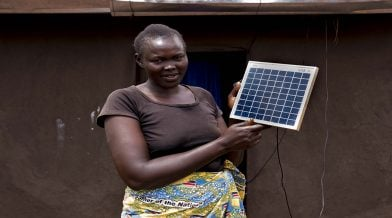 Refugee Rose Ben Aya with her solar panel