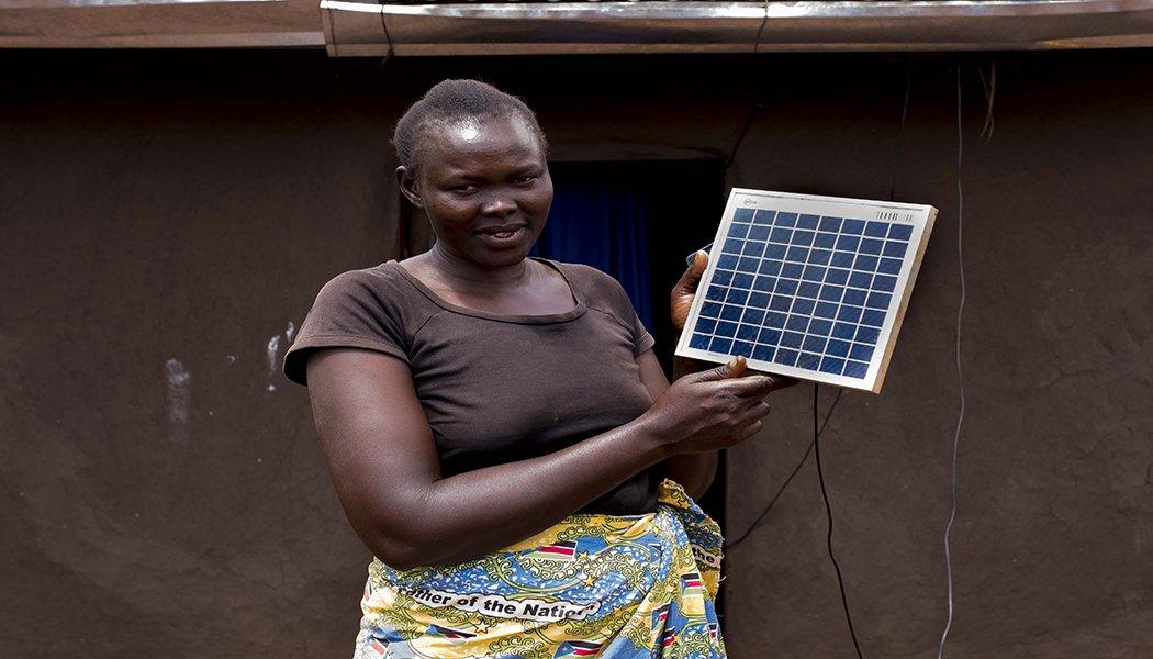 Refugee Rose Ben Aya with her solar panel
