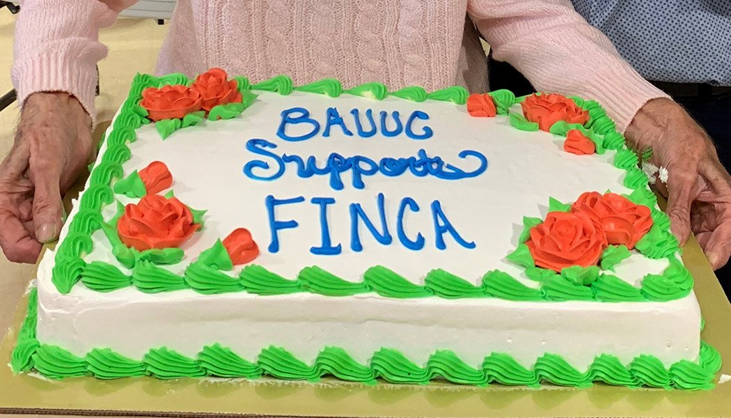 Ellie-Holding-FINCA-Cake