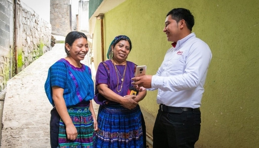 Paula Calabay and her daughter with a FINCA Guatemala loan officer.