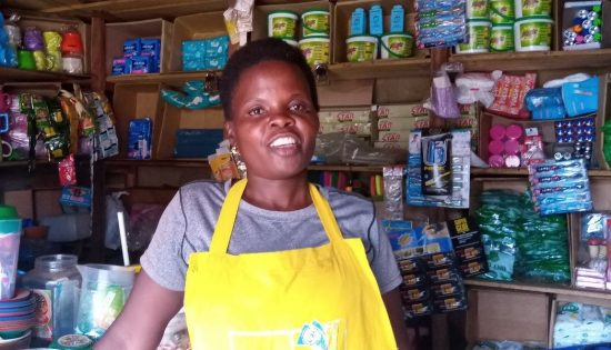 Jessica Asiimwe at her shop that sells basic household items in the town of Masindi.