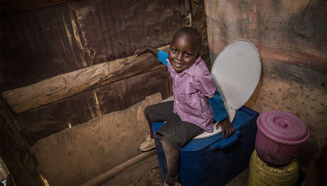 Boy sitting on a Blue Box