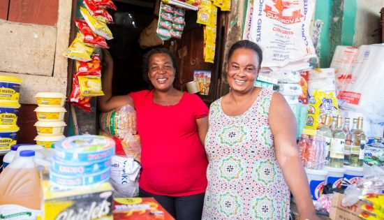 Charité Marcelin and a customer at her store.