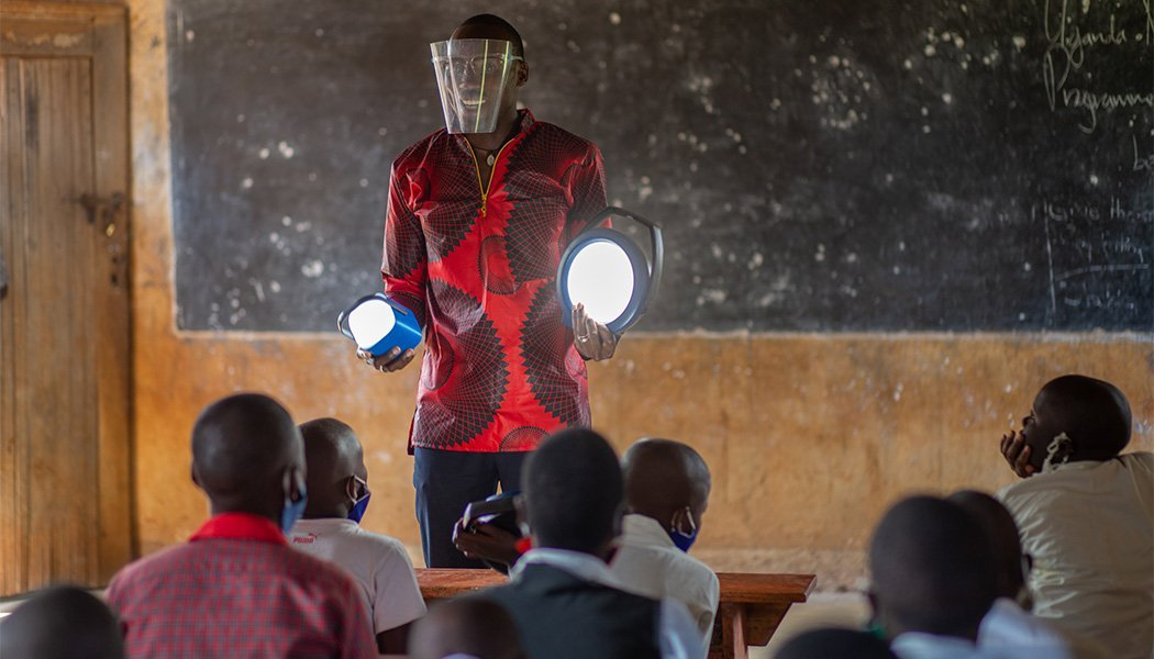A School Staff Member Smiles About the New Solar Lamps