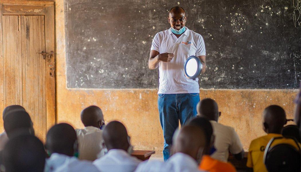 Nelson Mugisha Demonstrating a Solar Lamp